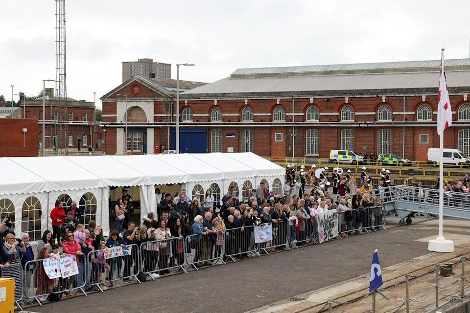 Pictured: Families wait for HMS Brocklesby to arrive at Portsmouth Naval Base. (Royal Navy/PA)