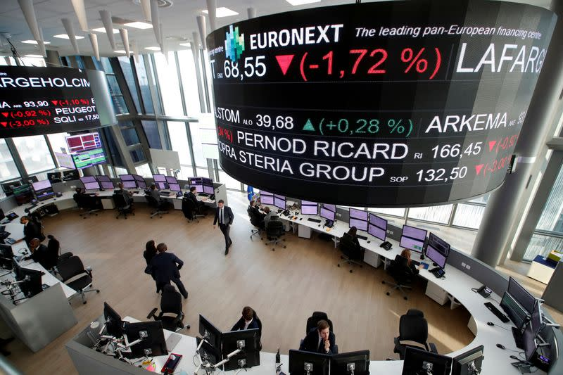 FILE PHOTO: Stock market operators work at the Euronext headquarters at La Defense business and financial district in Courbevoie near Paris