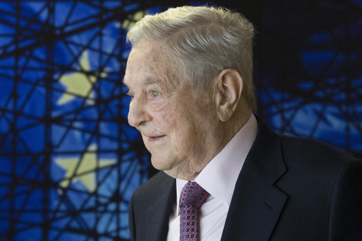FILE - In this Thursday, April 27, 2017 file photom, George Soros, Founder and Chairman of the Open Society Foundation, waits for the start of a meeting at EU headquarters in Brussels. (Olivier Hoslet/Pool Photo via AP)
