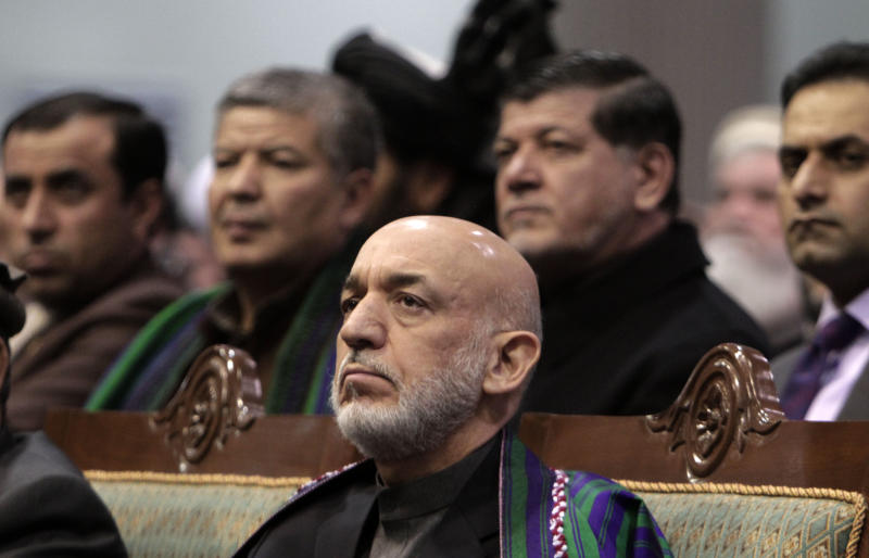 Afghan President Hamid Karzai attends the last day of the national consultative council known as a Loya Jirga in Kabul, Afghanistan, Sunday, Nov. 24, 2013. Afghanistan's president says he won't immediately sign a security deal with the United States, ignoring a recommendation by an assembly of Afghan elders and leaders that he do so by the end of the year. Hamid Karzai argued Afghanistan needed more time to ensure that the United States was committed to peace. (AP Photo/Rahmat Gul)