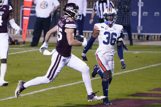Mississippi State wide receiver Austin Williams (85) runs past Auburn defensive back Jaylin Simpson (36) for a touchdown reception during the second half of an NCAA college football game Saturday, Dec. 12, 2020, in Starkville, Miss. (AP Photo/Rogelio V. Solis)