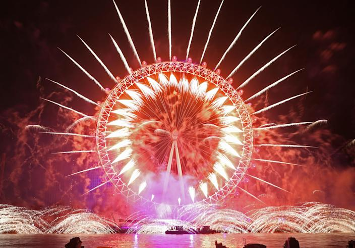 Fireworks light up the sky over the London Eye in central London during the New Year's Eve celebrations. (Photo: Yui Mok/PA Images via Getty Images)