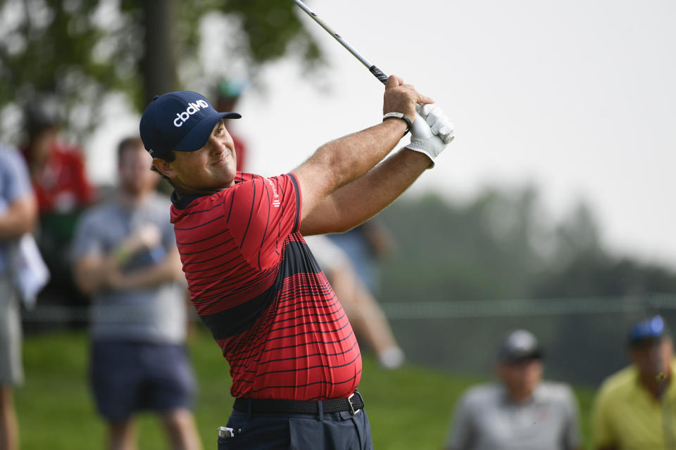 Patrick Reed watches his tee shot on the eighth hole during the first round of the 3M Open golf tournament in Blaine, Minn., Thursday, July 22, 2021. (AP Photo/Craig Lassig)
