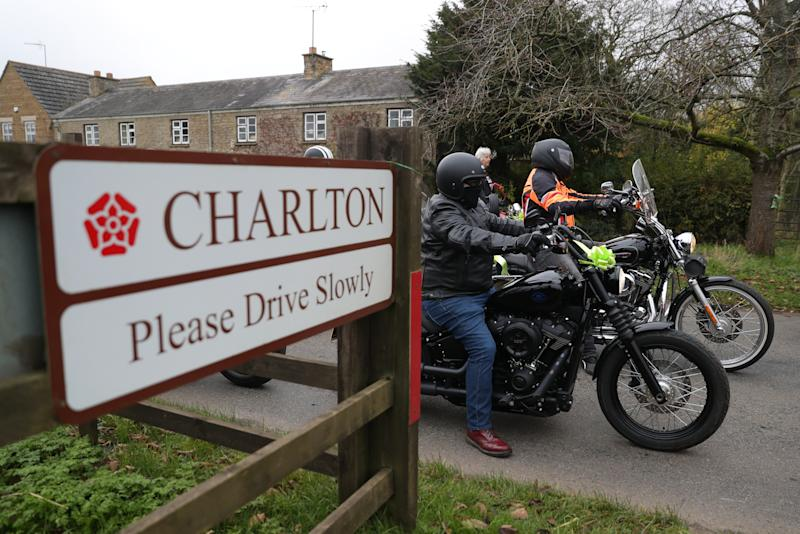 A motorbike convoy makes it's way through the village of Charlton as they follow Harry Dunn's last ride as a tribute to the teenager who died when his motorbike was involved in a head-on collision outside passes RAF Croughton, Northamptonshire, in August.