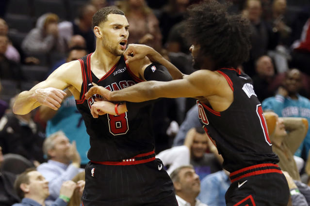 Chicago Bulls guard Zach LaVine celebrates his winning 3-point basket with teammate Coby White against the Charlotte Hornets on Saturday. (AP/Bob Leverone)