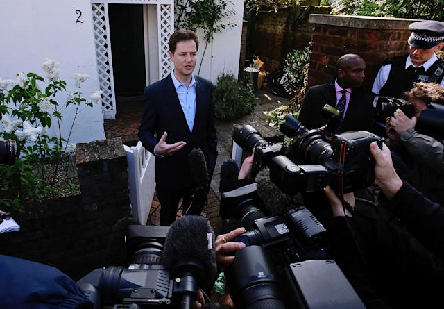 Nick Clegg speaks as Britain's Liberal Democrat leader to the media outside his home in London in 2010.