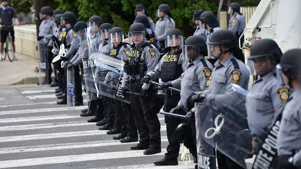 Police form a line to disallow access for a protest march through Center City on June 1, 2020 in Philadelphia, Pennsylvania. (Photo by Mark Makela/Getty Images)