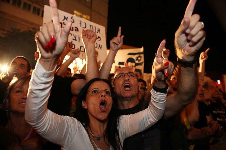 Israelis chant slogans as they march to the residence of Israel's Prime Minister Benjamin Netanyahu in Jerusalem on August 6. Netanyahu on Sunday promised change as he tried to ease growing anger over the cost of living after an unprecedented number of Israelis took part in nationwide protests