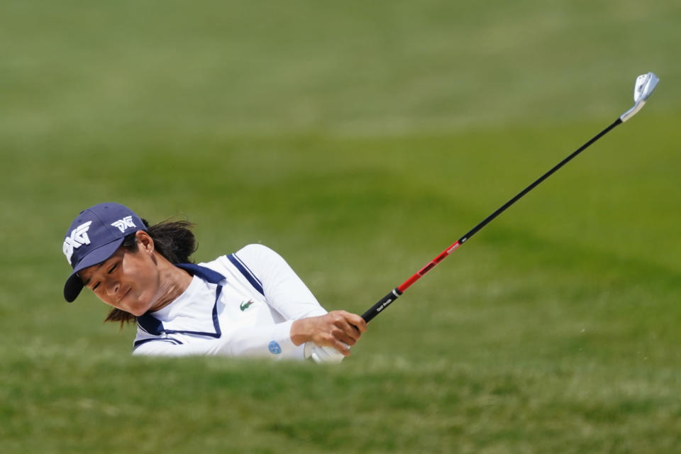 Celine Boutier, of France, hits from a fairway bunker on the eighth hole during the second round of play in the KPMG Women's PGA Championship golf tournament Friday, June 25, 2021, in Johns Creek, Ga. (AP Photo/John Bazemore)