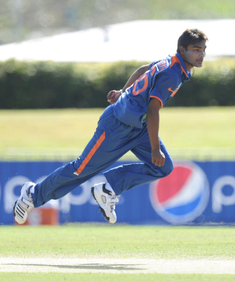 TOWNSVILLE, AUSTRALIA - AUGUST 20:  Sandeep Sharma of India bowls during the ICC U19 Cricket World Cup 2012 Quarter Final match between India and Pakistan at Tony Ireland Stadium on August 20, 2012 in Townsville, Australia.  (Photo by Ian Hitchcock-ICC/Getty Images)
