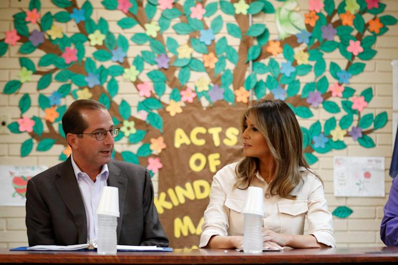 Melania speaks with US Secretary of Health and Human Services Alex Azar during the visit (REUTERS)