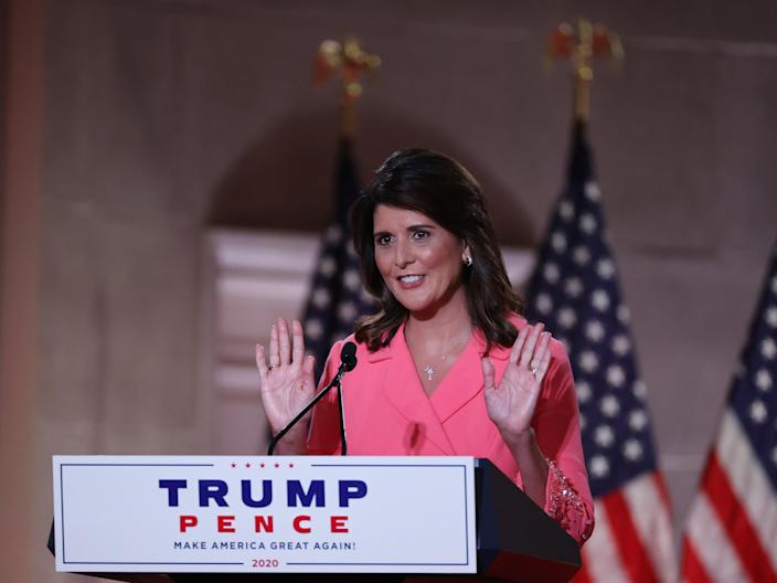 <p>Former US Ambassador to the United Nations Nikki Haley stands on stage in an empty Mellon Auditorium while addressing RNC at the Mellon Auditorium on 24 August 2020 in Washington, DC.</p> ((Getty Images))