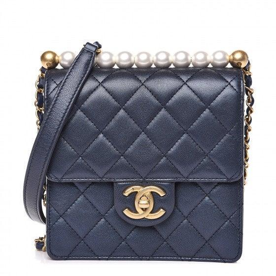 "<br><br><strong>Chanel</strong> Iridescent Lambskin Quilted Bag, $, available at <a href=""https://go.skimresources.com/?id=30283X879131&url=https%3A%2F%2Fwww.fashionphile.com%2Fchanel-iridescent-lambskin-quilted-chic-pearls-flap-navy-blue-525408"" rel=""nofollow noopener"" target=""_blank"" data-ylk=""slk:Fashionphile"" class=""link rapid-noclick-resp"">Fashionphile</a>"