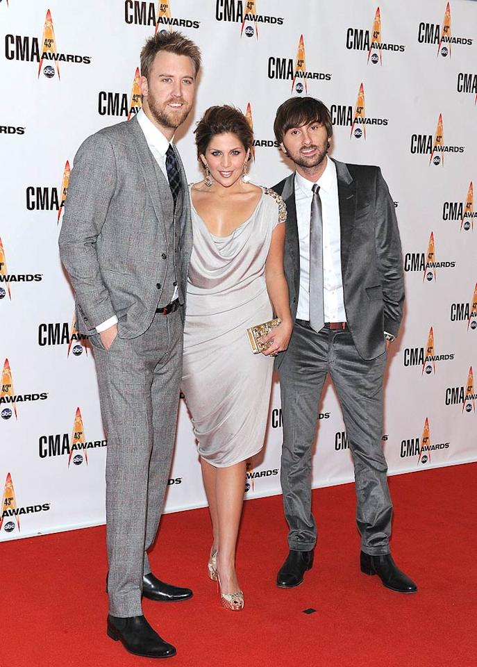 """Lady Antebellum  Grade: B  The tailored trio (Charles Kelley, Hillary Scott, and Dave Haywood) were surprisingly sophisticated in matching gray ensembles. Frederick Breedon/<a href=""""http://www.gettyimages.com/"""" target=""""new"""">GettyImages.com</a> - November 11, 2009"""