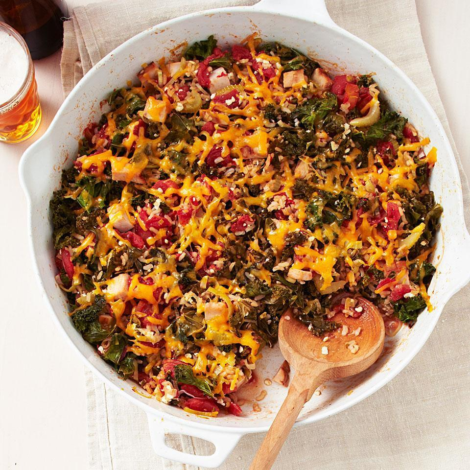 """<p>This hearty one-skillet dinner is loaded with celery, kale, tomatoes and quick-cooking brown rice. It's easy to make the recipe vegetarian by substituting smoked tofu for the turkey. <a href=""""http://www.eatingwell.com/recipe/250591/smoked-turkey-kale-rice-bake/"""" rel=""""nofollow noopener"""" target=""""_blank"""" data-ylk=""""slk:View recipe"""" class=""""link rapid-noclick-resp""""> View recipe </a></p>"""