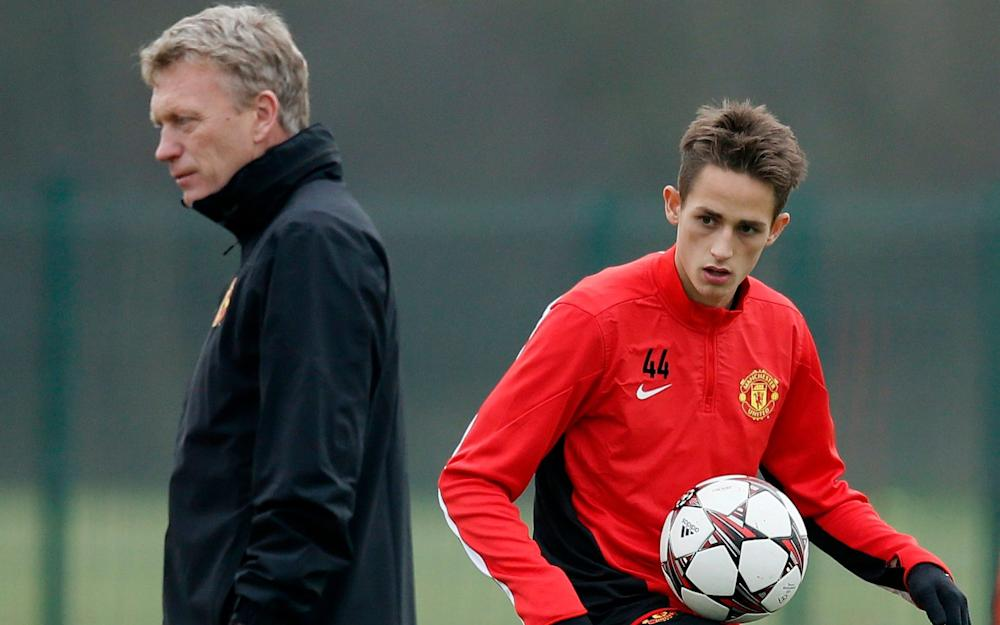 Adnan Januzaj (R) kicks a ball as manager David Moyes looks on - Credit: Reuters