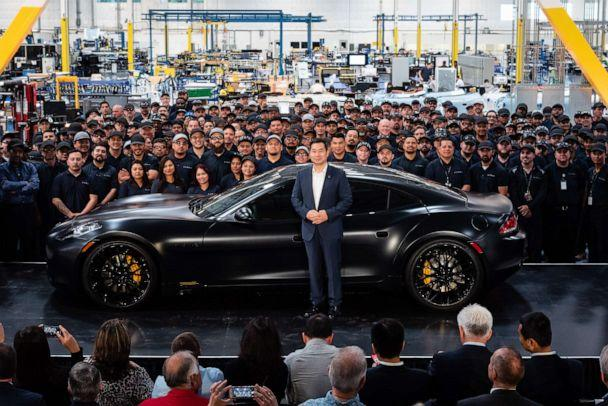 PHOTO: Dr. Lance Zhou, CEO of Karma Automotive, presenting the first Revero car at the company's Customization & Innovation Center in Moreno Valley, California. (Karma Automotive)
