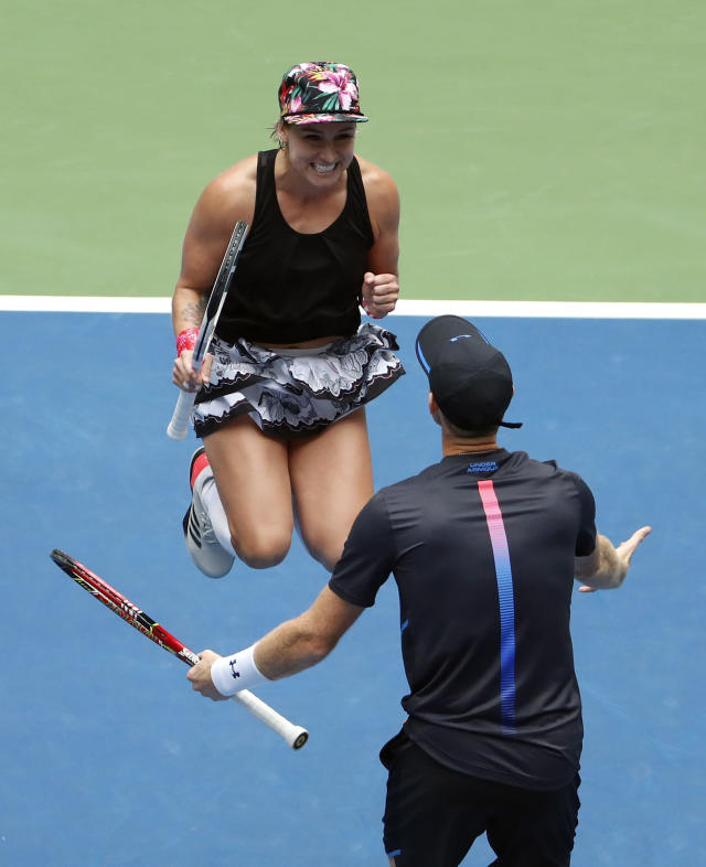 Bethanie Mattek-Sands and Jamie Murray, of Great Britain, celebrate after defeating Alicja Rosolska, of Poland, and Nikola Mektic, of Croatia, in the mixed doubles finals of the U.S. Open tennis tournament, Saturday, Sept. 8, 2018, in New York. (AP Photo/Adam Hunger)