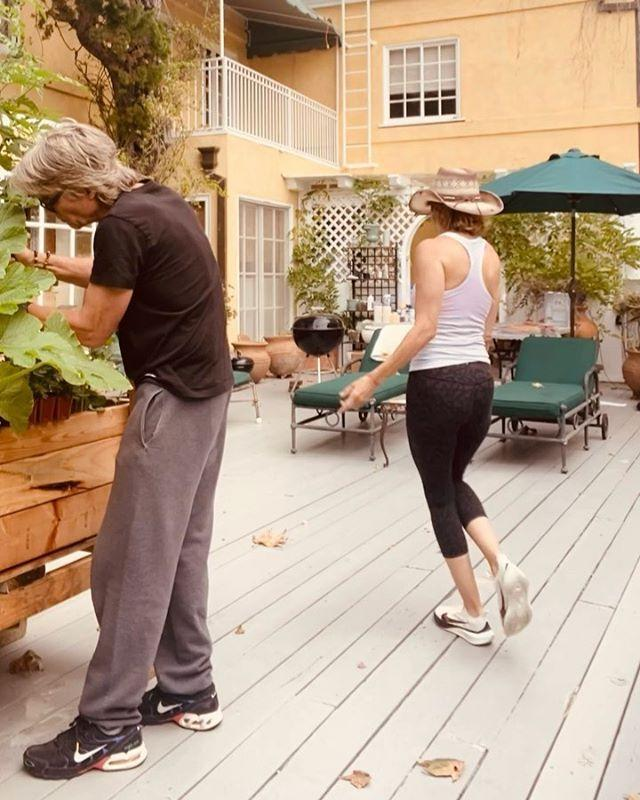 <p>Is that ... is that Harry Hamlin?! The star's husband of more than two decades was hilariously unimpressed with her moves, ignoring her dance break in favor of his gardening in this playful clip. </p>