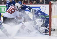 New Jersey Devils' Drew Stafford (18) is stopped by Vancouver Canucks goalie Jacob Markstrom, of Sweden, during the first period of an NHL hockey game Friday, March 15, 2019, in Vancouver, British Columbia. (Darryl Dyck/The Canadian Press via AP)