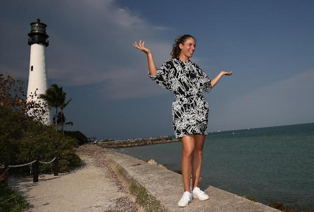 Johanna Konta of Great Britain poses during a photo shoot after she defeated Caroline Wozniacki of Denmark in the final at Cape Florida on April 1, 2017 in Key Biscayne, Florida (AFP Photo/JULIAN FINNEY)
