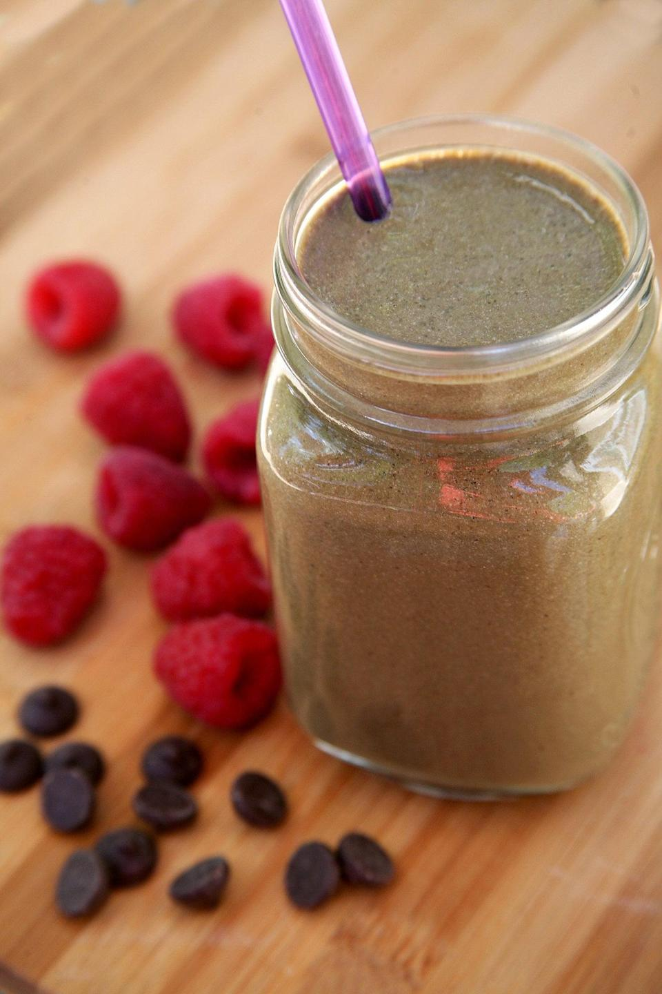 """<p>This smoothie is packed with protein and will fulfill all your chocolate cravings.</p> <p><strong>Protein:</strong> 22.1 grams</p> <p><strong>Get the recipe:</strong> <a href=""""https://www.popsugar.com/fitness/Chocolate-Vegan-Smoothie-34820459"""" class=""""link rapid-noclick-resp"""" rel=""""nofollow noopener"""" target=""""_blank"""" data-ylk=""""slk:chocolate raspberry smoothie"""">chocolate raspberry smoothie</a></p>"""