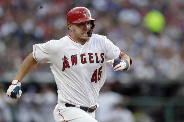 American League's Mike Trout, of the Los Angeles Angels, grounds out during the first inning of the MLB baseball All-Star Game against the National League, Tuesday, July 9, 2019, in Cleveland. Trout is wearing the number of Los Angeles Angels pitcher Tyler Skaggs who recently passed away. (AP Photo/Tony Dejak)