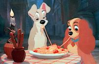 An unusual kissing scene for sure, but still a romantic one. Disney's animated film 'Lady and the Tramp' shows the two dogs sharing a plate of spaghetti. Not paying attention the canine lovers chew on the same piece of pasta, before their mouths meet.