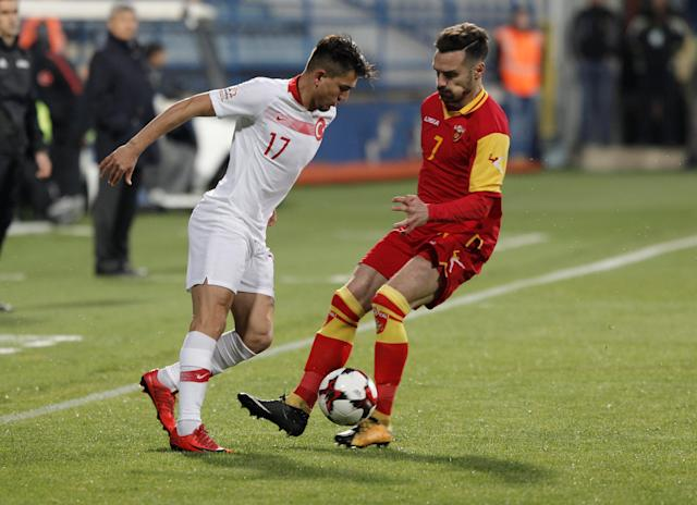 Soccer Football - International Friendly - Montenegro vs Turkey - Podgorica City Stadium, Podgorica, Montenegro - March 27, 2018 Turkey's Cengiz Under in action with Montenegro's Marko Vesovic REUTERS/Stevo Vasiljevic