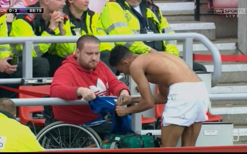 Lingard signing a shirt for a fan - Credit: Sky Sports