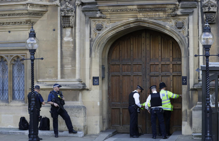 Police officers guard an entrance to Britain's Parliament in London, Thursday, Aug. 29, 2019. British Prime Minister Boris Johnson manoeuvred Wednesday to give his political opponents less time to block a no-deal Brexit split from Europe before the Oct. 31 withdrawal deadline, winning Queen Elizabeth II's approval to suspend Parliament.(AP Photo/Kirsty Wigglesworth)