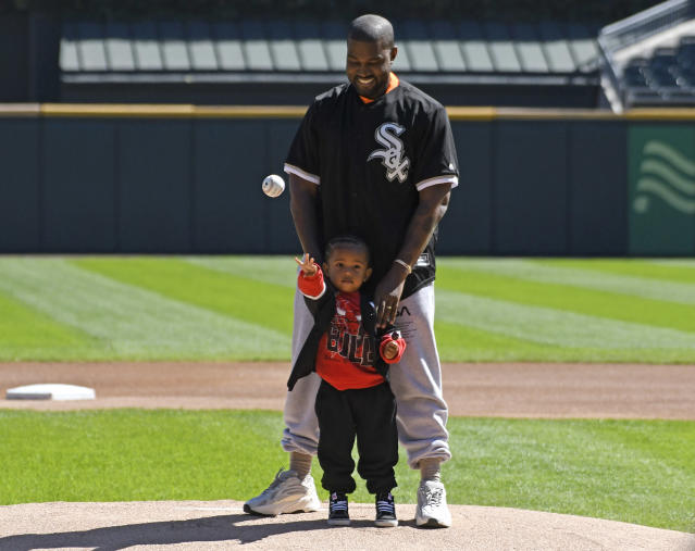 "Kanye West and his son Saint throw out the first pitch at Sunday's <a class=""link rapid-noclick-resp"" href=""/mlb/teams/chw"" data-ylk=""slk:Chicago White Sox"">Chicago White Sox</a> game. (Getty Images)"