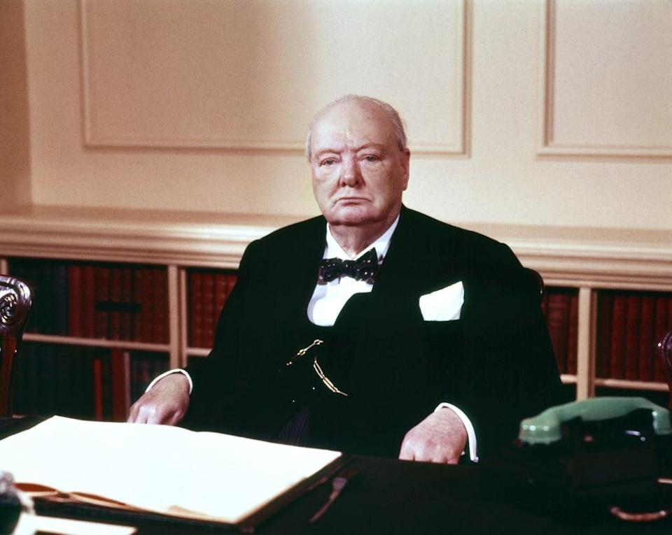 Sir Winston Churchill in the cabinet room at 10 Downing Street (PA) (PA Archive)