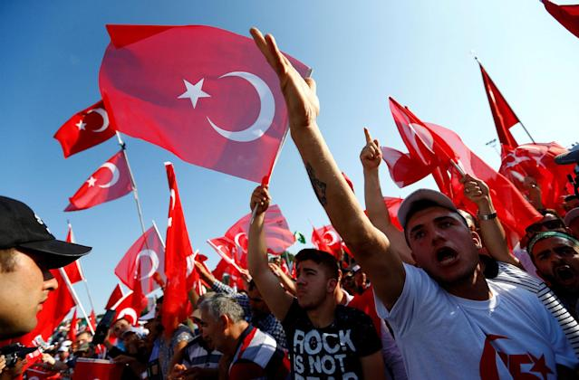 <p>People wave Turkey's national flags as they arrive to attend a ceremony marking the first anniversary of the attempted coup at the Bosphorus Bridge in Istanbul, Turkey, July 15, 2017. (Photo: Murad Sezer/Reuters) </p>