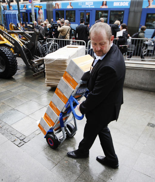 A man delivers boxed copies of the second report, of some 300 pages, regarding the mental health of Anders Behring Breivik, to the court in Oslo, Norway, Tuesday, April 10, 2012. According to the new psychiatric assessment report, the right-wing extremist, Anders Breivik, who has confessed to killing 77 people in a bomb and shooting rampage in Norway on July 22, 2011, is not criminally insane, contradicting an earlier assessment. (AP Photo / Erlend Aas, Scanpix) NORWAY OUT