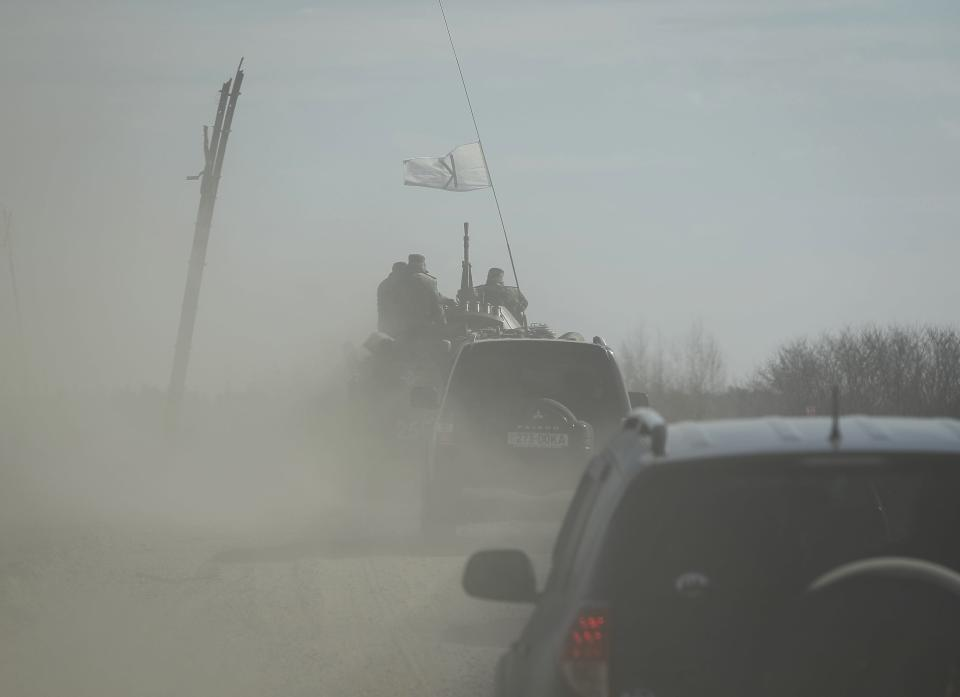 Ukrainian soldiers ride on military armoured personnel carriers during a military exercise near the village of Goncharivske March 14, 2014. U.S. President Barack Obama said on Friday he still hopes for a diplomatic solution to the Ukraine crisis heading into a pivotal weekend. REUTERS/Gleb Garanich