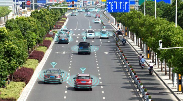 a road populated by self driving cars