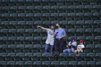 Fans watch batting practice before Game 1 of the baseball World Series between the Los Angeles Dodgers and the Tampa Bay Rays Tuesday, Oct. 20, 2020, in Arlington, Texas. (AP Photo/Eric Gay)