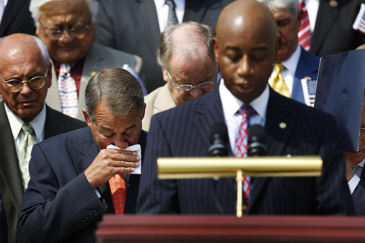 U.S. House Speaker John Boehner (R-OH) (L) wipes away tears after speaking at a remembrance of lives lost in the 9/11 attacks, at the U.S. Capitol in Washington, September 11, 2013. Bagpipes, bells and a reading of the names of the nearly 3,000 people killed when hijacked jetliners crashed into the World Trade Center, the Pentagon and a Pennsylvania field marked the 12th anniversary of the September 11 attacks in 2001. REUTERS/Jonathan Ernst (UNITED STATES - Tags: POLITICS ANNIVERSARY DISASTER)