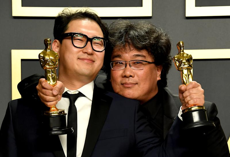 Han Jin-won and Bong Joon-ho with their Oscars for Best Original Screenplay, International Feature Film, Best Director, and Best Picture for Parasite in the press room at the 92nd Academy Awards held at the Dolby Theatre in Hollywood, Los Angeles, USA. (Photo by Jennifer Graylock/PA Images via Getty Images)