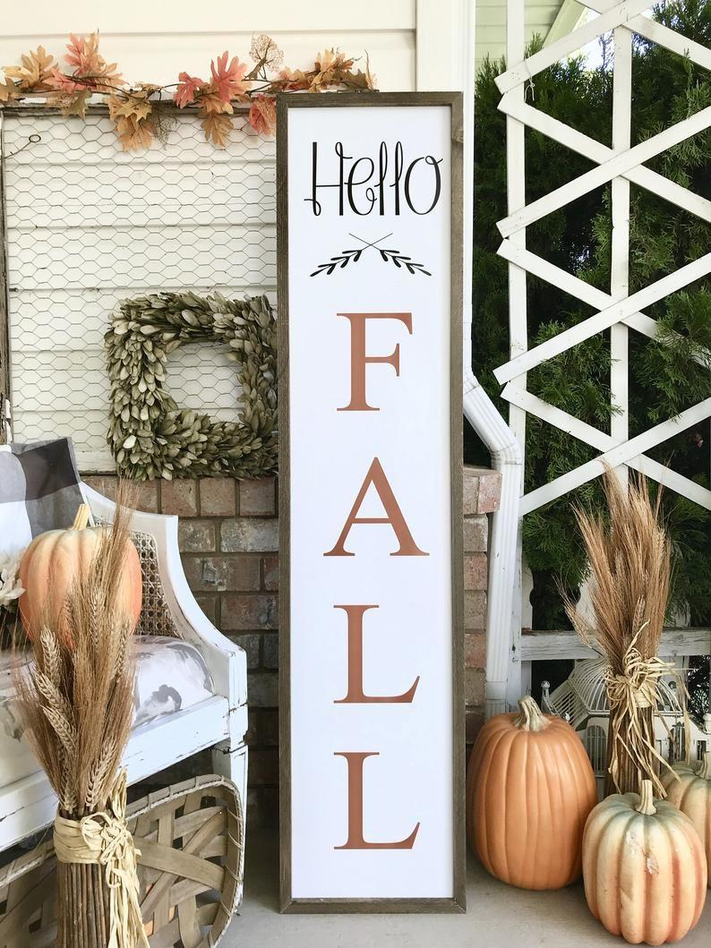 """<p><strong>TheHolidayPorch</strong></p><p>etsy.com</p><p><strong>$75.00</strong></p><p><a href=""""https://go.redirectingat.com?id=74968X1596630&url=https%3A%2F%2Fwww.etsy.com%2Flisting%2F736734337%2Fcute-hello-fall-halloween-fall&sref=https%3A%2F%2Fwww.oprahmag.com%2Flife%2Fg33335421%2Ffall-porch-decor-ideas%2F"""" rel=""""nofollow noopener"""" target=""""_blank"""" data-ylk=""""slk:SHOP NOW"""" class=""""link rapid-noclick-resp"""">SHOP NOW</a></p><p>Usher in the new season—and any guests you're expecting—with a pretty wooden sign. You can also make one yourself for a more budget-friendly option.</p>"""