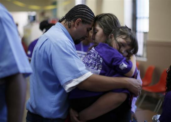 Jessica (C), 28, says goodbye to Abel, 32, as she holds their five-year-old daughter Camila at San Quentin state prison in San Quentin, California June 8, 2012.