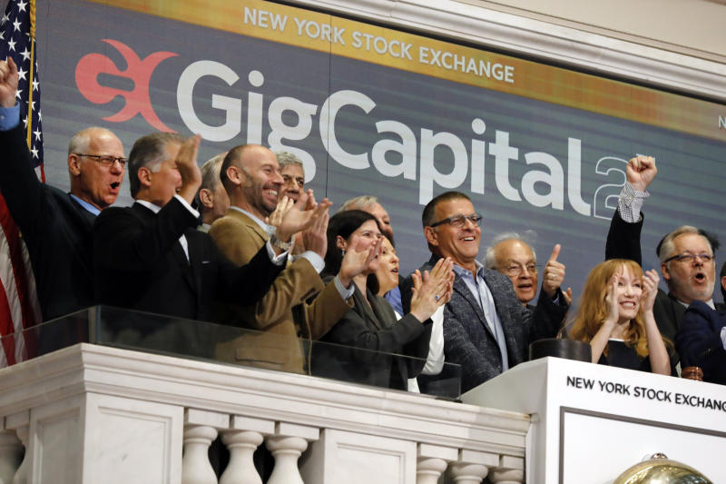 GigCapital2 CEO Dr. Avi Katz, fourth from right, gives a thumbs-up as he rings the New York Stock Exchange opening bell, Tuesday, June 11, 2019, to celebrate the recent IPO of the company. (AP Photo/Richard Drew)