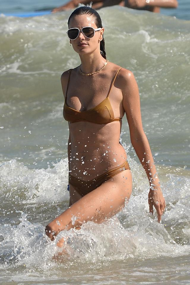<p>Alessandra Ambrósio takes a dip in the ocean in Los Angeles on Saturday.</p>