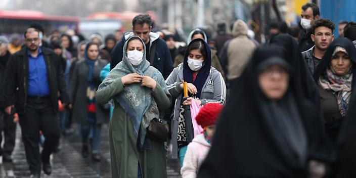 Iranian women wear protective masks to prevent contracting a coronavirus, as they walk at Grand Bazaar in Tehran, Iran February 20, 2020. WANA (West Asia News Agency)/Nazanin Tabatabaee via REUTERS