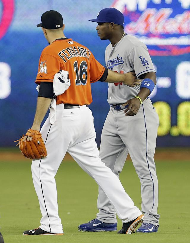 Miami Marlins starting pitcher Jose Fernandez (16) greets Los Angeles Dodgers right fielder Yasiel Puig in the outfield before a baseball game, Monday, Aug. 19, 2013 in Miami. (AP Photo/Lynne Sladky)