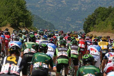 FILE PHOTO: Riders cycle during the 110.5-km (68.6 miles) 20th stage of the 102nd Tour de France cycling race from Modane to Alpe d'Huez in the French Alps mountains, France, July 25, 2015. REUTERS/Stefano Rellandini