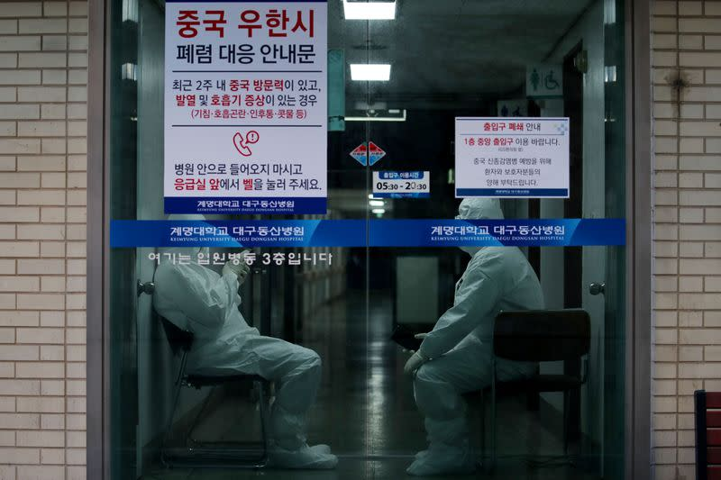 Medical workers stand by at a hospital in Daegu