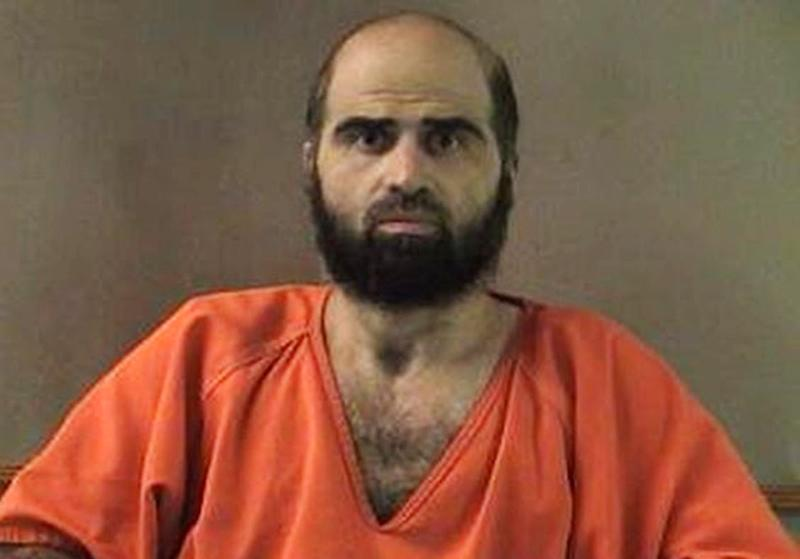 FILE - This undated file photo provided by the Bell County Sheriff's Department shows Army psychiatrist Maj. Nidal Hasan. Hasan collected nearly $300,000 in his military salary while awaiting trial for the 2009 shooting rampage at Fort Hood, but his attorney said nearly all of it has been given to charity _ likely making it impossible for his victims to get any of it. (AP Photo/Bell County Sheriff's Department, File)