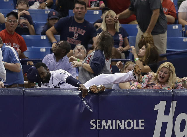 Tampa Bay Rays left fielder Denard Span goes into the stands chasing a foul ball hit by Boston Red Sox's Mitch Moreland during the fourth inning of a baseball game Thursday, May 24, 2018, in St. Petersburg, Fla. Moreland eventually struck out on the at-bat. (AP Photo/Chris O'Meara)
